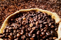 Coffee beans, some in a sack