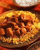 Indian chicken tikka masala on saffron rice