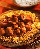 Indian chicken tikka masala on saffron rice