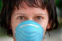 Woman wearing sanitary sterile mask for hygienic reasons over mouth and nose in the time of disease and germs and bugs and illness
