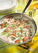 Pork fillet in herb mousse with tomatoes and basil