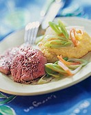 Poached beef fillet with polenta and leeks