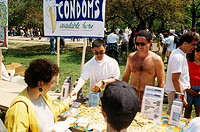 Gay Men´s Health Crisis (GMHC) employees distributing free condoms at the AIDS Walk, New York, NY.