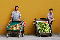 Two local fruit sellers in Suzhou, Jiangsu Province, China