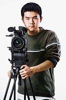 Asian man with video camera