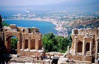 Greek theatre and Giardini-Naxos in background. Taormina. Sicily, Italy