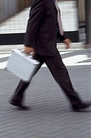 Businessman with briefcase, movement
