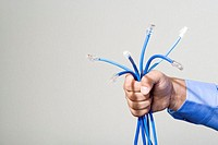 Man holding network cables