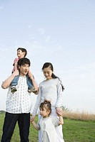 Asian family in a field