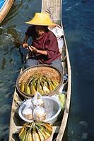 Thailand, Bangkok, floating market of Damoen Saduak, woman paddling