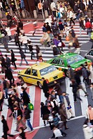 Japan, Tokyo, Shibuya, commuters crossing street (blurred motion)