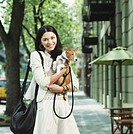 Young woman holding   Basenji dog