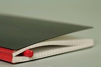Colored crayon in a notebook, close-up, selective focus
