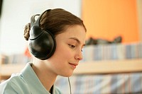 Girl listening to music by earphones
