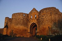 France, Dordogne, Domme, Porte des Tours at sunrise