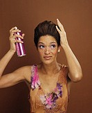 Woman Applying Hair Spray