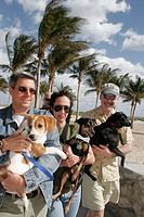 Serpentine Trail, dogs, owners. Lummus Park, Ocean Drive, Miami Beach, Florida, (USA)
