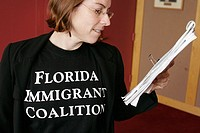 White female, Immigrant Coalition, advocate. Immigration Summit. Government Center. Miami. Florida. USA.