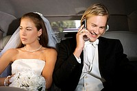 Bride and groom using cell phone