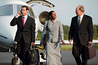 Business people on airport tarmac