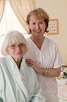 Health care worker assisting a patient