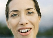 Woman's face, smiling at camera