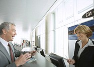 Businessman at airline check-in counter