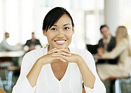 Young female office worker smiling