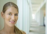 Woman standing in corridor, portrait
