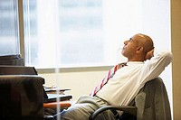 Side profile of a businessman sitting in an office