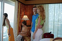 Young couple with their son and daughter in a hotel room