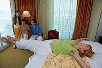 High angle view of a young couple with their son and daughter in a hotel room