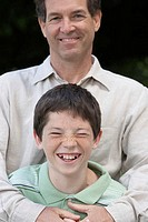 Portrait of a mid adult man smiling with his son