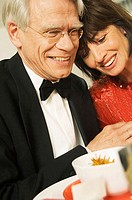 Close-up of a mature couple smiling