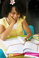 Close-up of a girl doing her homework