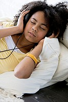 Close-up of a girl listening to music