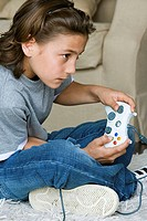 Side profile of a boy playing a video game