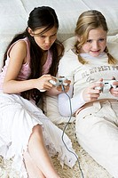 High angle view of two girls playing a video game