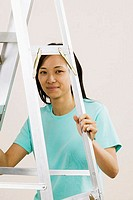Portrait of a young woman holding a ladder (thumbnail)