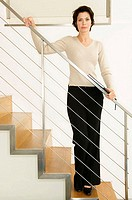 Businesswoman standing on a staircase