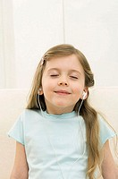 Close-up of a girl wearing headphones and listening to music