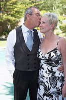 Close-up of a mature man kissing a mature woman