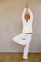 Senior woman in tree pose