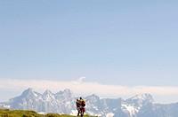 Austria, Salzburger Land, Mature couple hiking, rear view