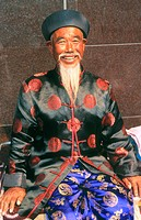 Old man in traditional dress. Gardens Bazar. Shanghai. China.