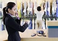 Customer at dry cleaner, Edmonds, Washington, United States