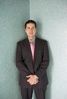 Hispanic businessman standing in a corner facing out, Richmond, Virginia, United States