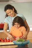 Hispanic mother and daughter making a salad, Richmond, Virginia, United States