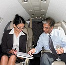 Businesswoman and businessman inside airplane, Perth, Australia