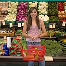Young woman in produce section of supermarket, Perth, Australia